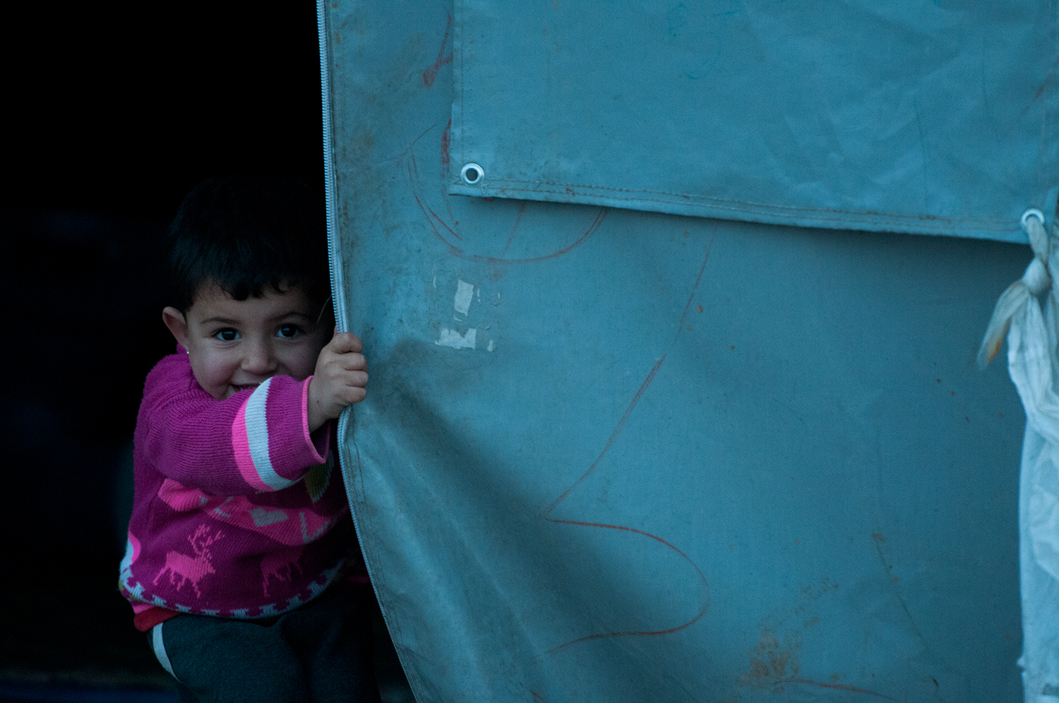 Syrian child playing in a refuge camp near Suruç