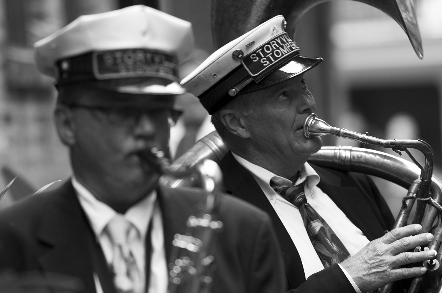 Storyville Stompers brass band marching down the streets of the French Quarter.