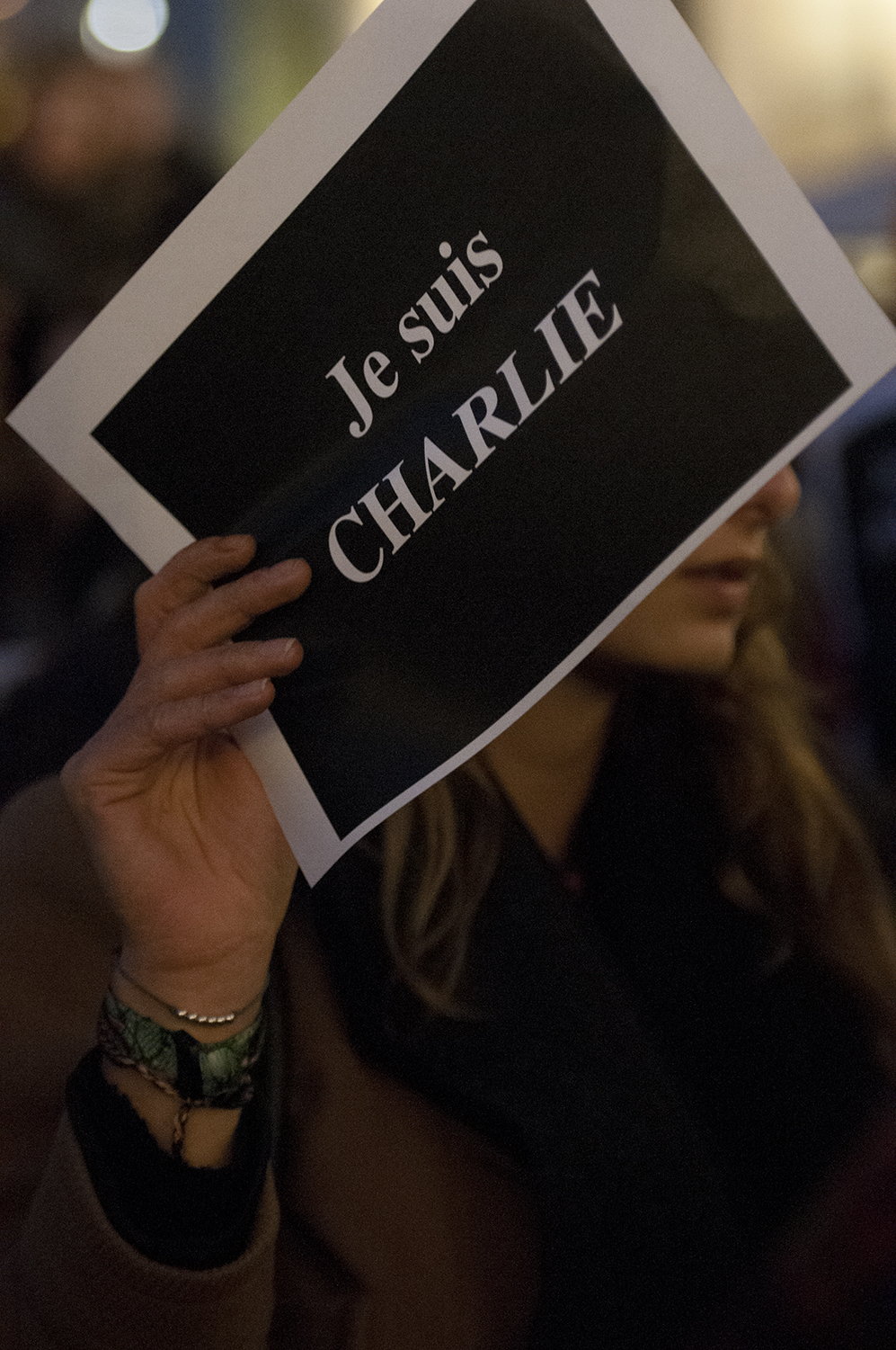 "Young Woman holding up the sign ""I am Charlie"""