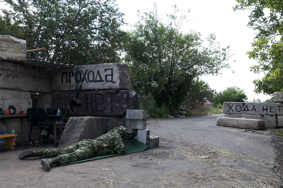 Sniper from the Patriot Battalion scouting from a checkpoint located near the front line