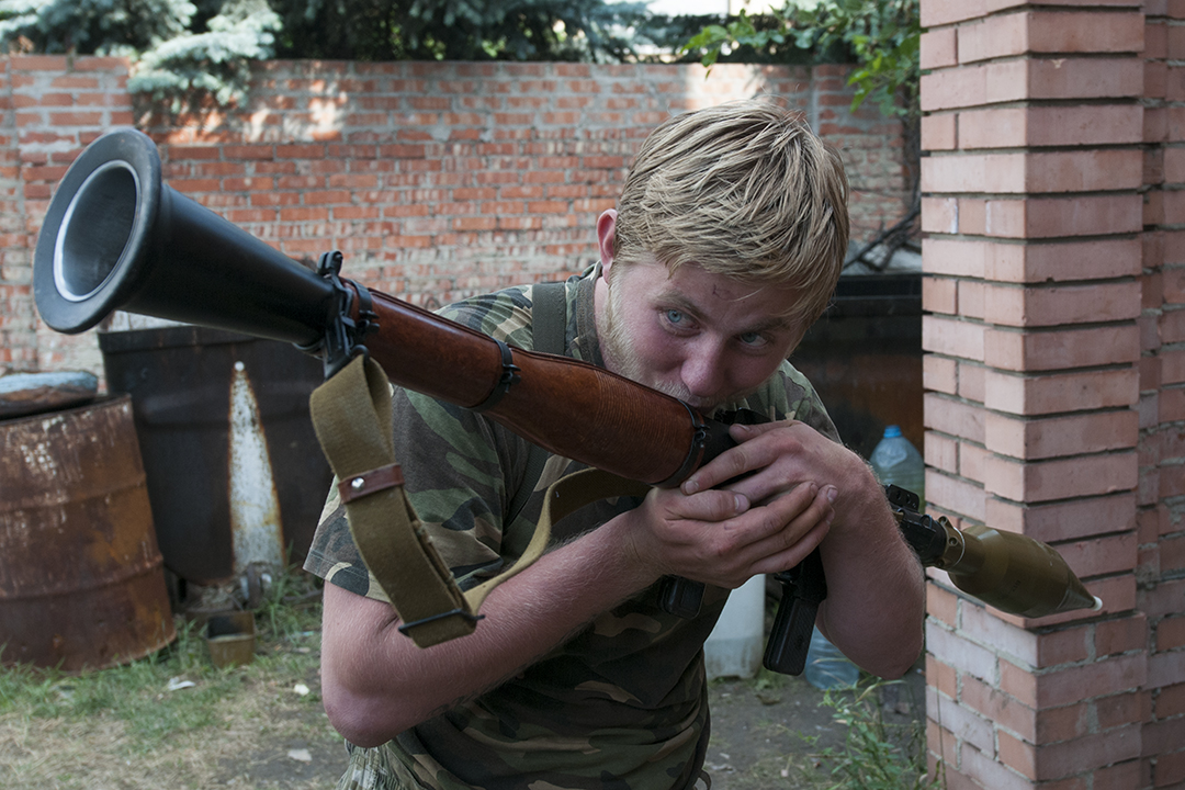 """""""Blondinki"""", 19, kissing his RPG launcher and calling it he's girlfriend as he mess around with his comrades"""