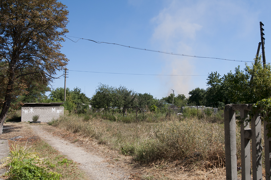 Smoke rising during shelling in Luhanske during the poultry distribution.