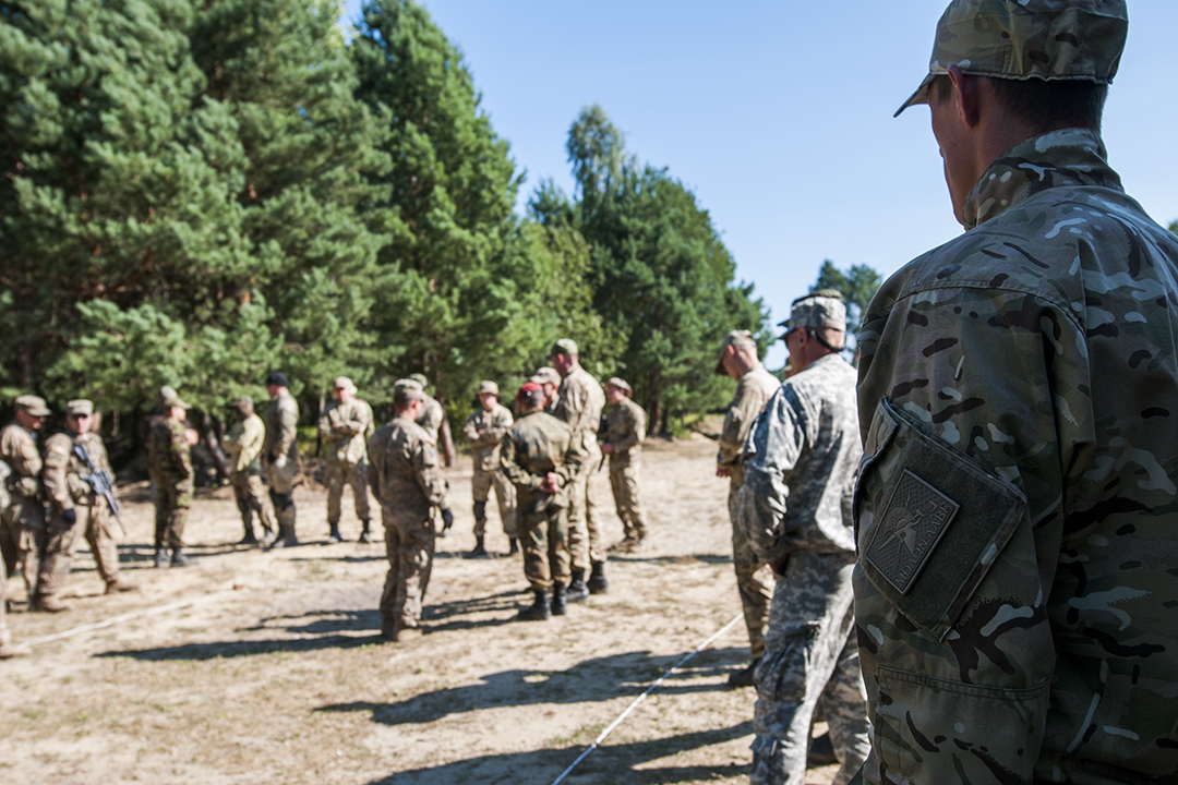 Ukrainian soldier listening to U.S. instructors.