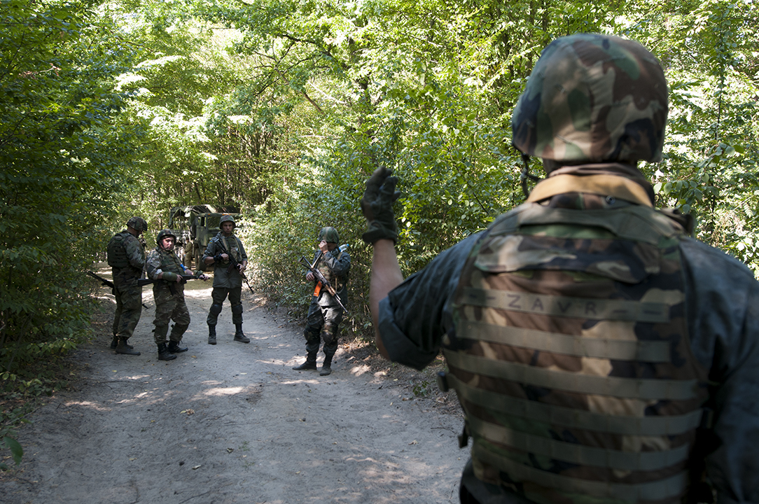 Team leader from the Ukrainian National Guard giving instruction to his soldiers at the beginning of a patrol exercise.