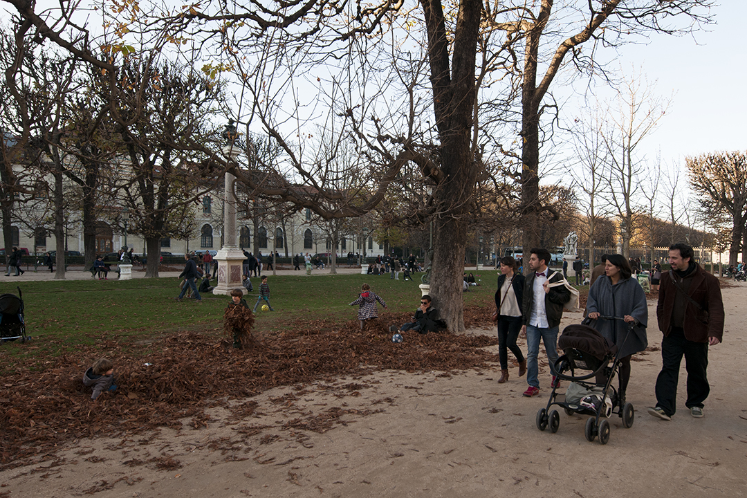 Kids playing in autumn leaves on Avenue de l'Observatoire.