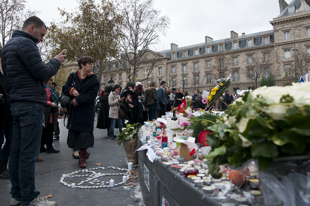 Parisians paying their respects to the 129 victims who lost their lives and the 352 wounded.