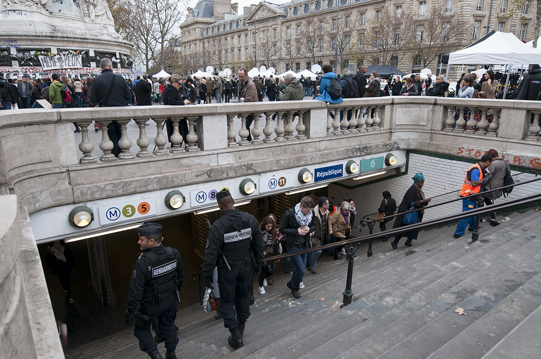 """Not Even Afraid"". Gendarmes on patrol going down to the metro."