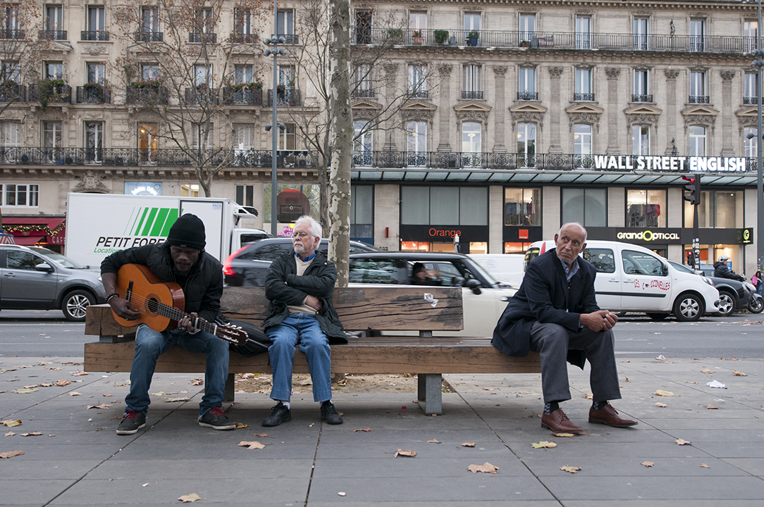 Black-Blanc-Beur. A musician playing a song about fraternity on Place de la République.