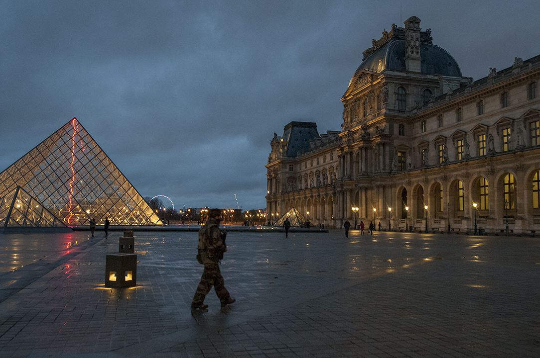 A female soldier from the French Army paroling the Louvre.