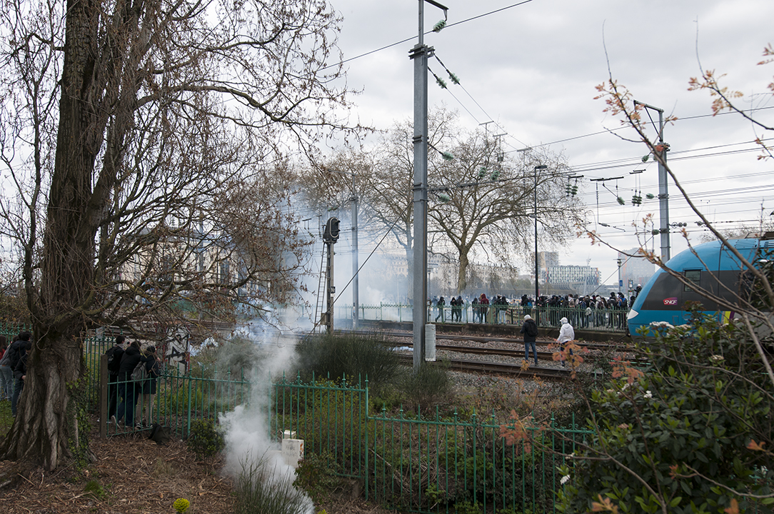 Tear gas fired by the Police to repel the protesters away from the railway.