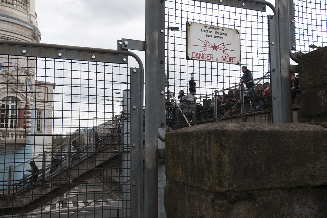 Protesters teasing the Police from a bridge located above the railway.