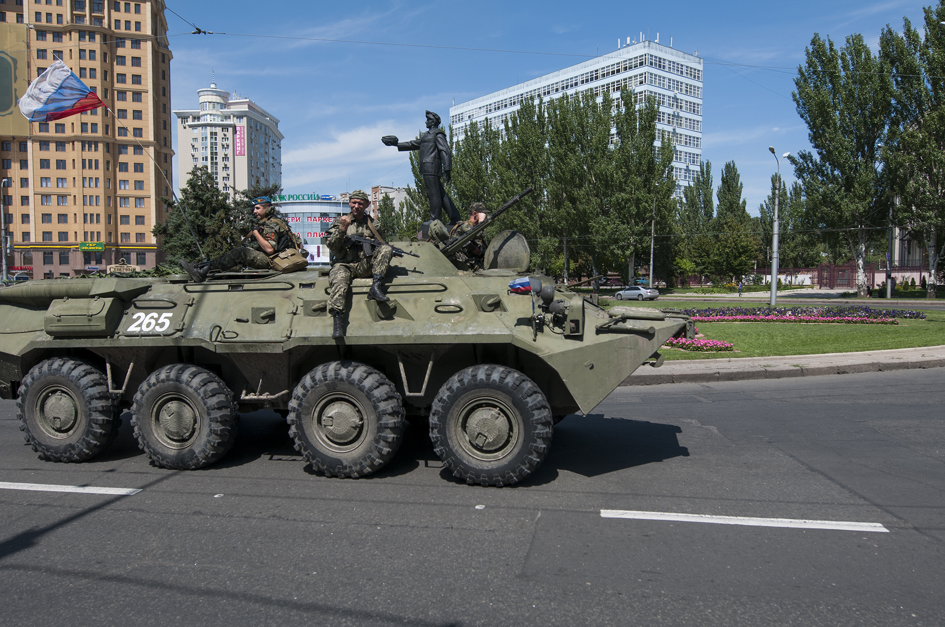 Pro-Russian separatist cheering from the top of his BTR on its way to battle