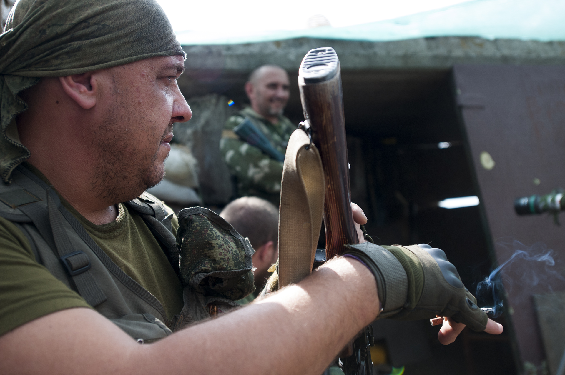 Russian backed separatist smoking at his fortified position on the front line