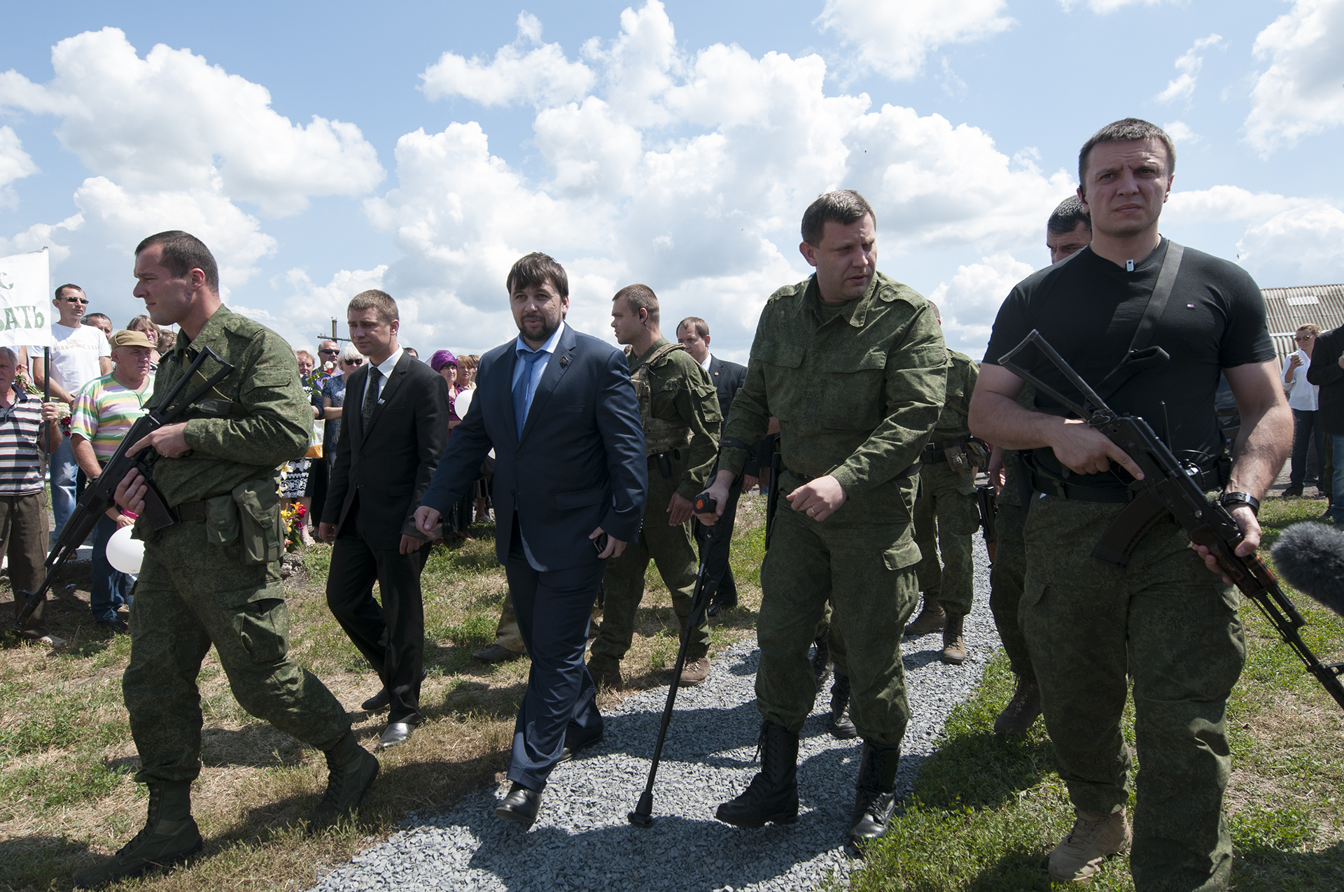 Rebel leaders Alexander Zakharchenko, second right, and Denis Pushilin, third right, arrive at the memorial ceremony at the crash site of the Malaysian Airlines MH17