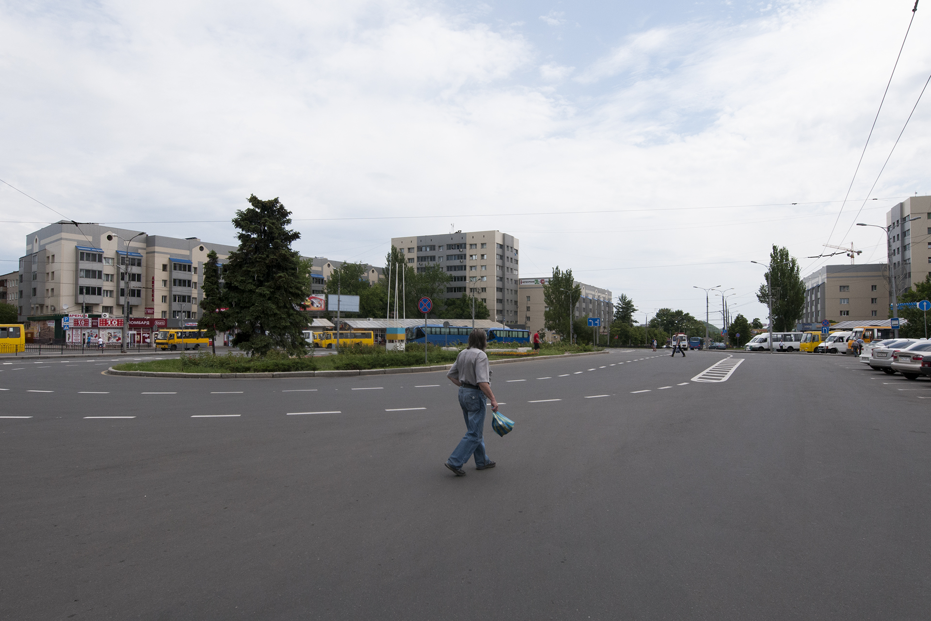 Man crossing the esplanade of Donetsk train station