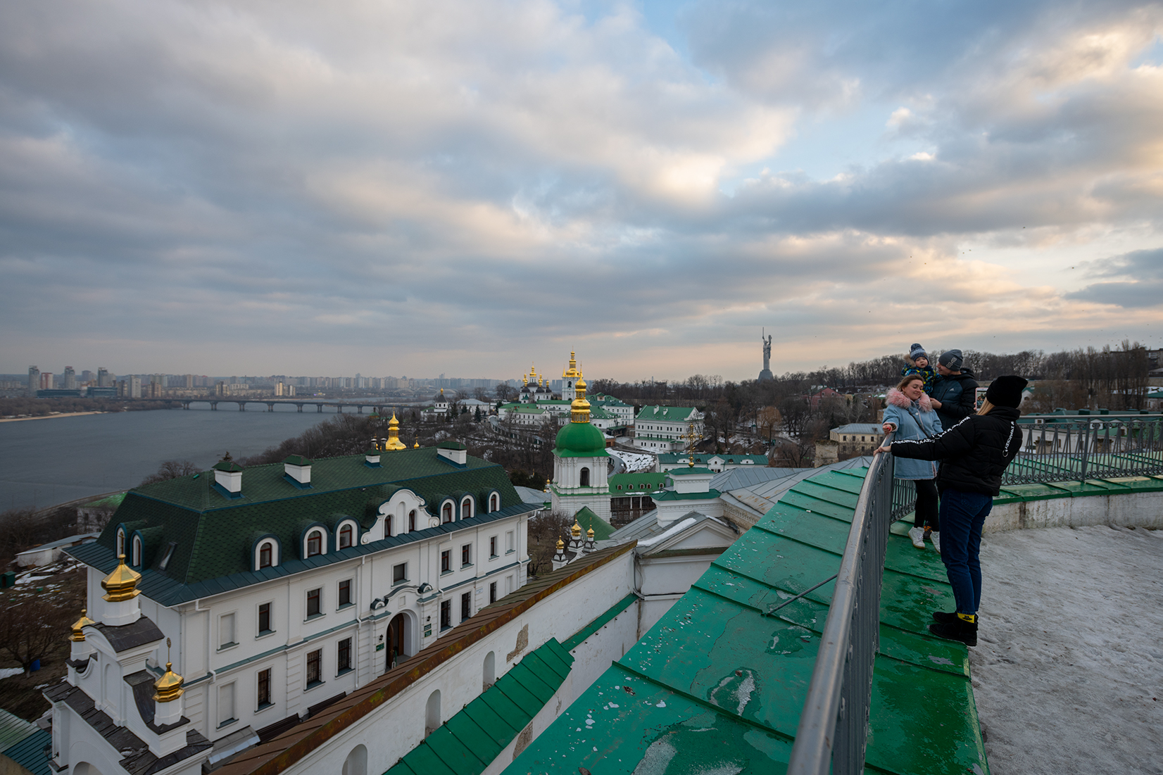 A family taking pictures from a viewpoint above the Dnieper