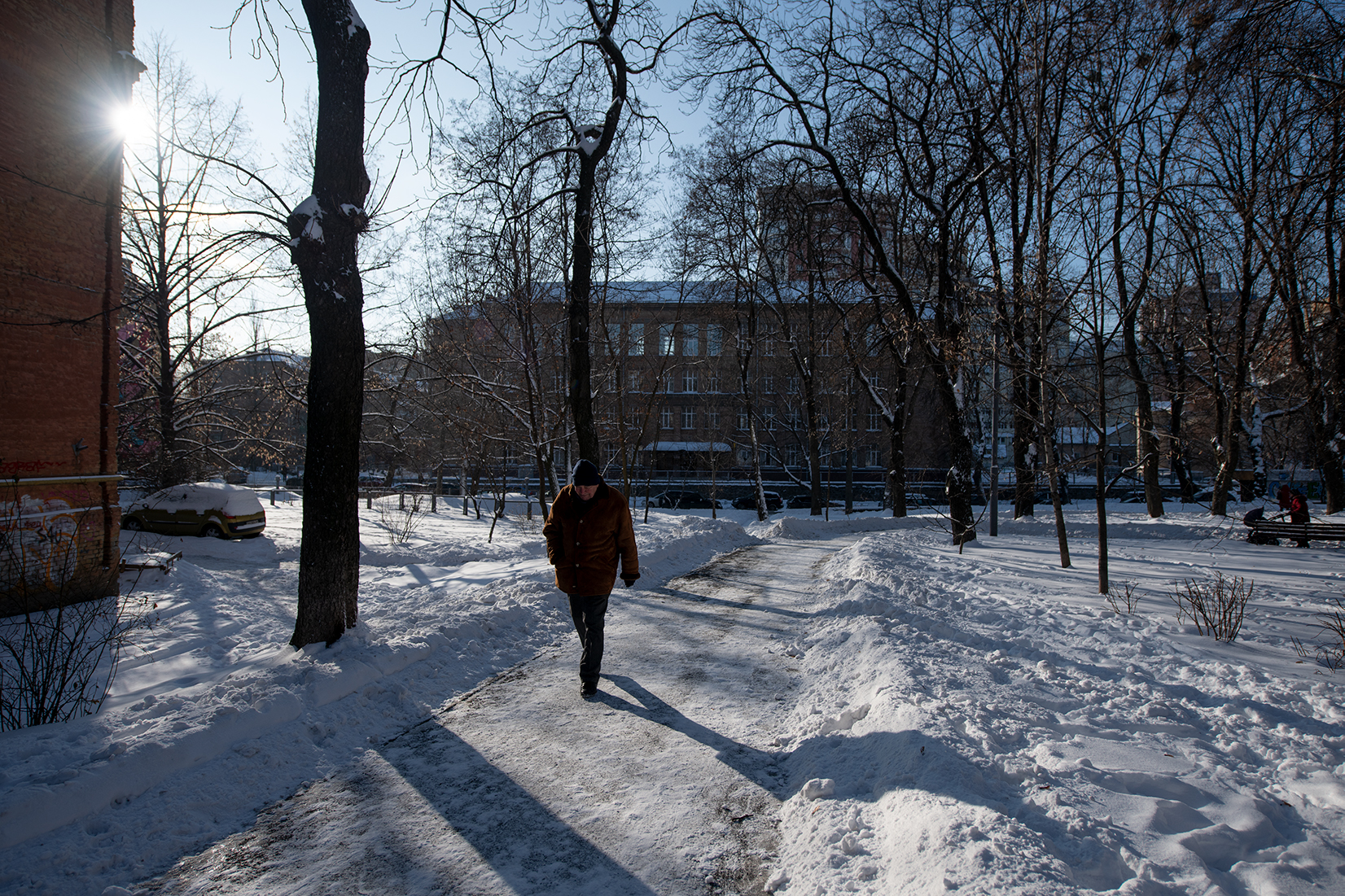 A man walking through Pavlivsʹkyy Sadok park