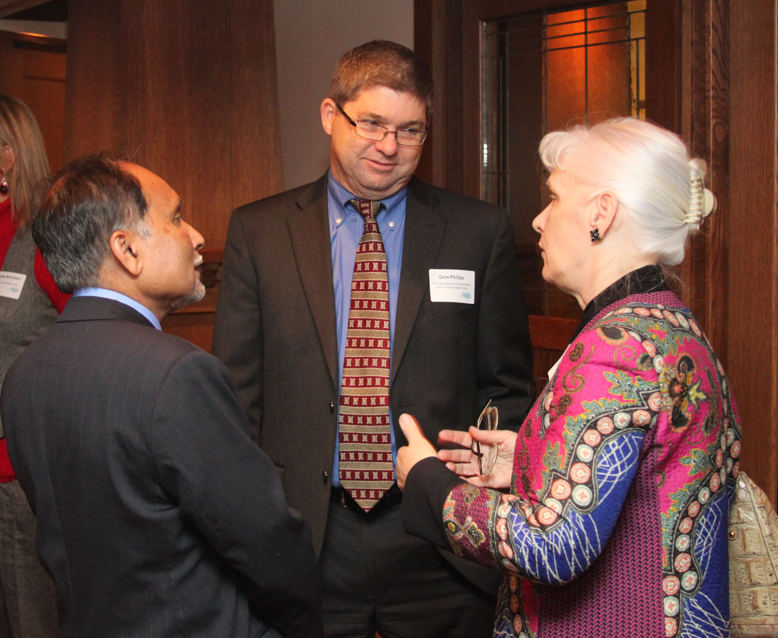 Dr. Zaman and Gene Phillips, Civil engineering alumnus, welcome OU Provost Nancy Mergler.
