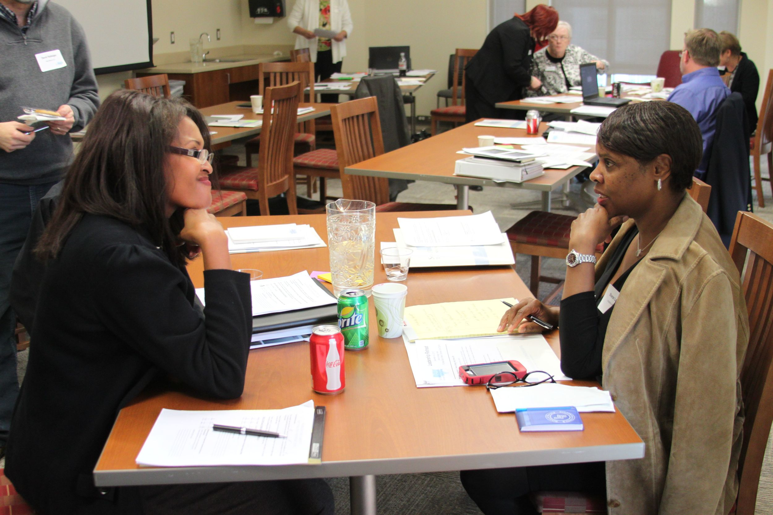 Sharon Lewis, Associate Director from Langston University and a colleague collaborate.