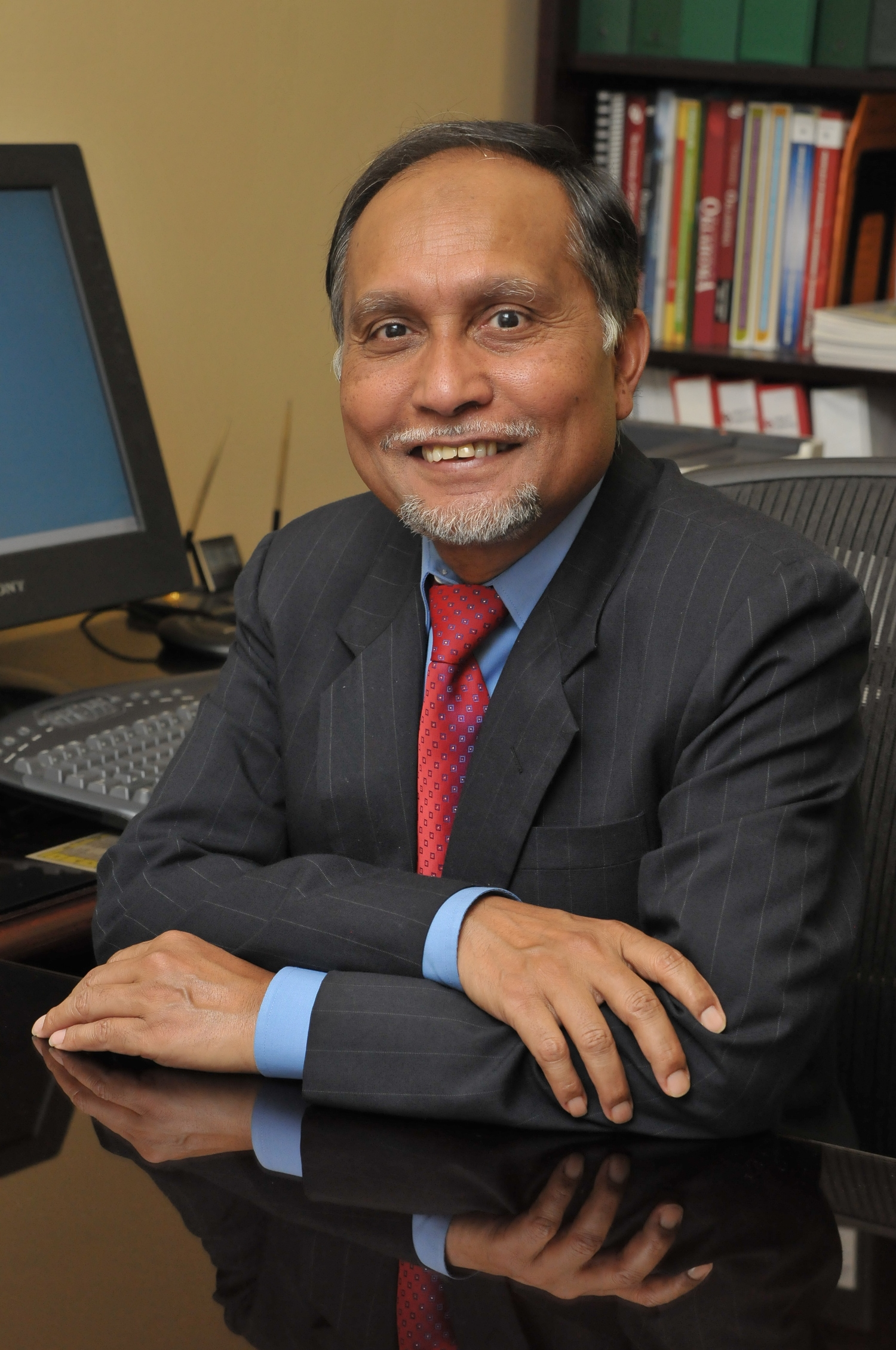 Dr. MUSHARRAF ZAMAN