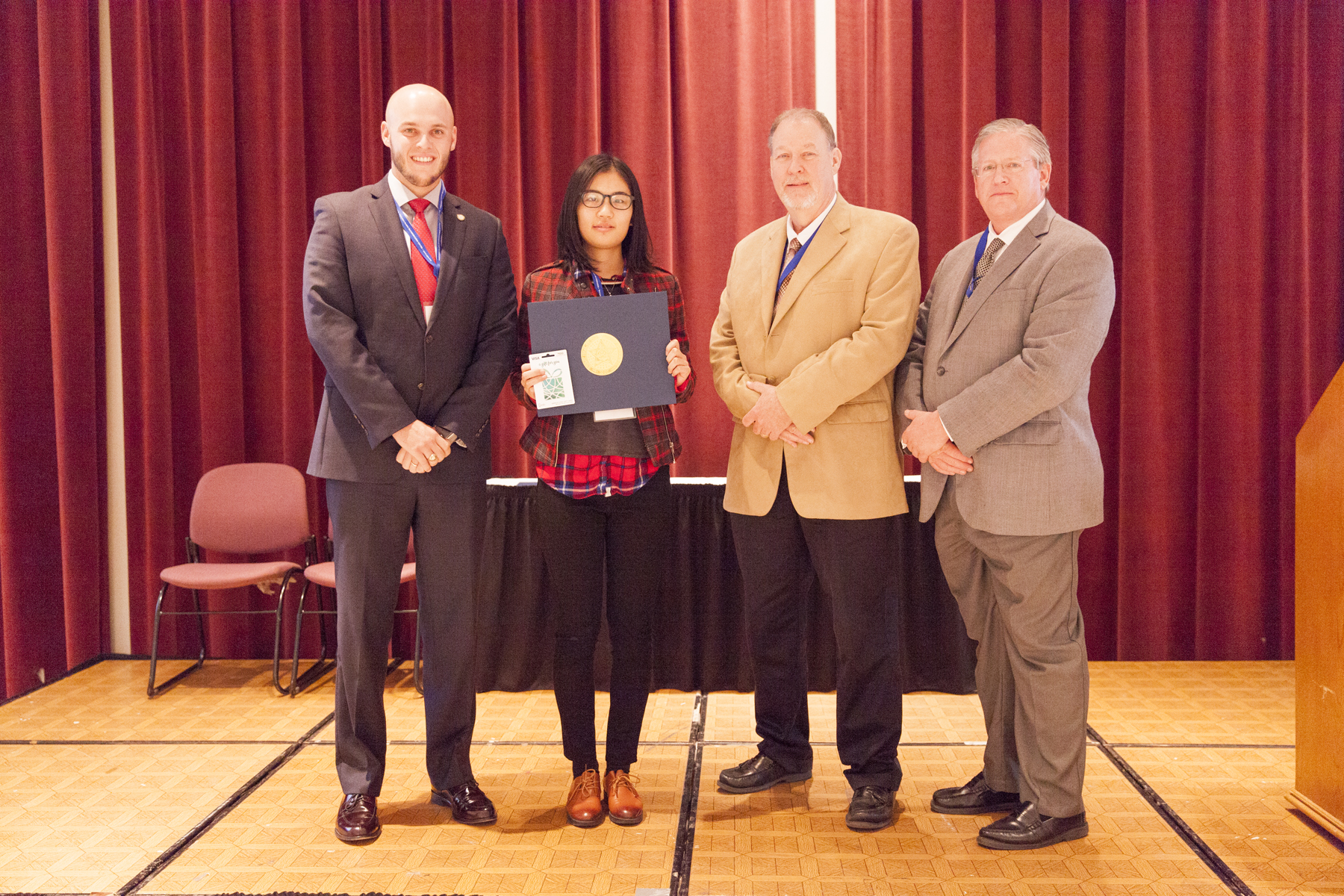 """Ning Lee – OSU - wins 2nd Place in the Oklahoma Transportation Research Day Poster Competition for her work titled """"Laboratory Test on Slab/Base Friction in Concrete Pavement""""."""