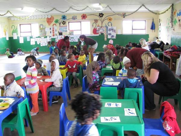 The volunteers in action along with a bunch of happy children!