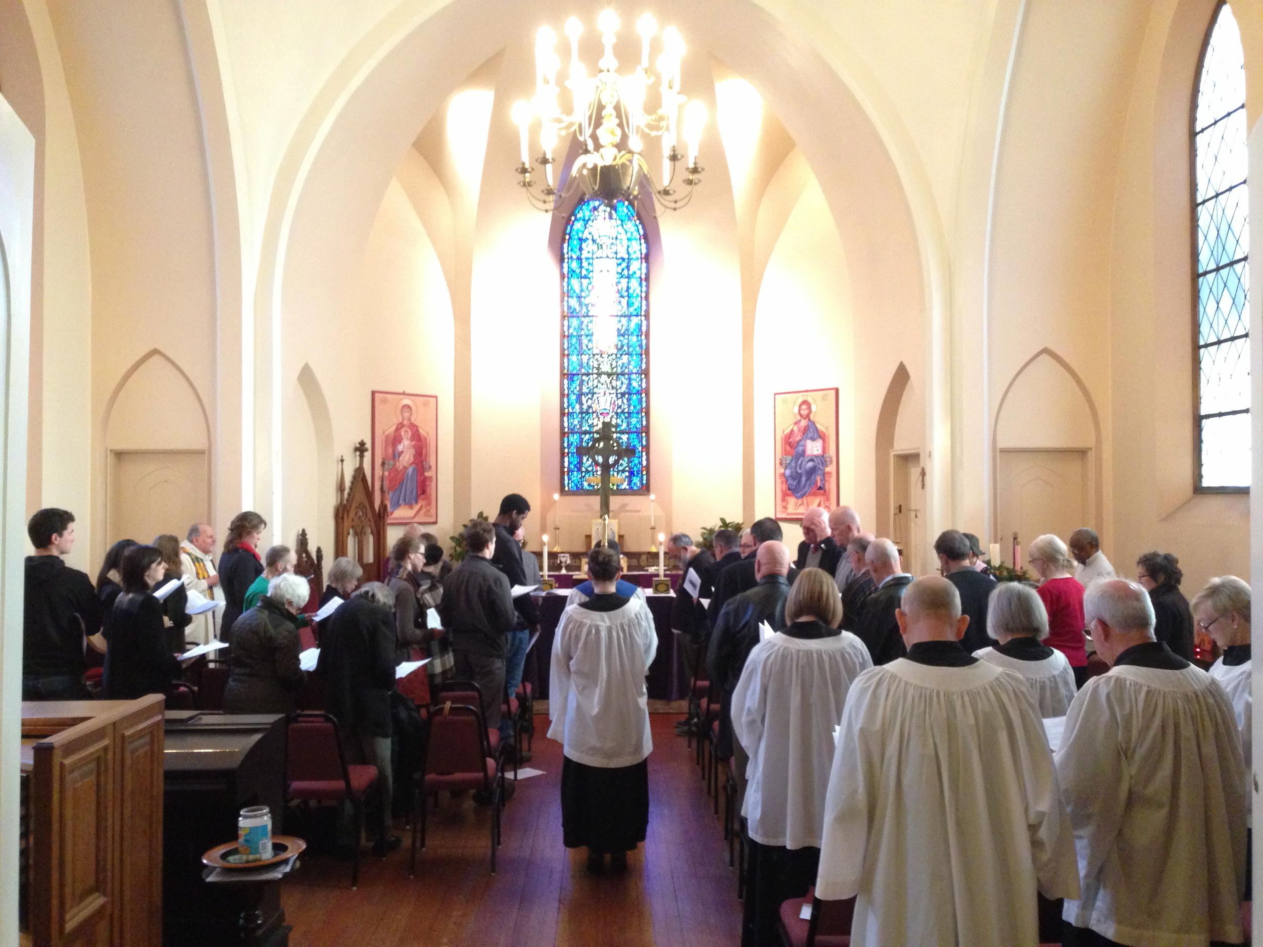 Congregation singing in unison.