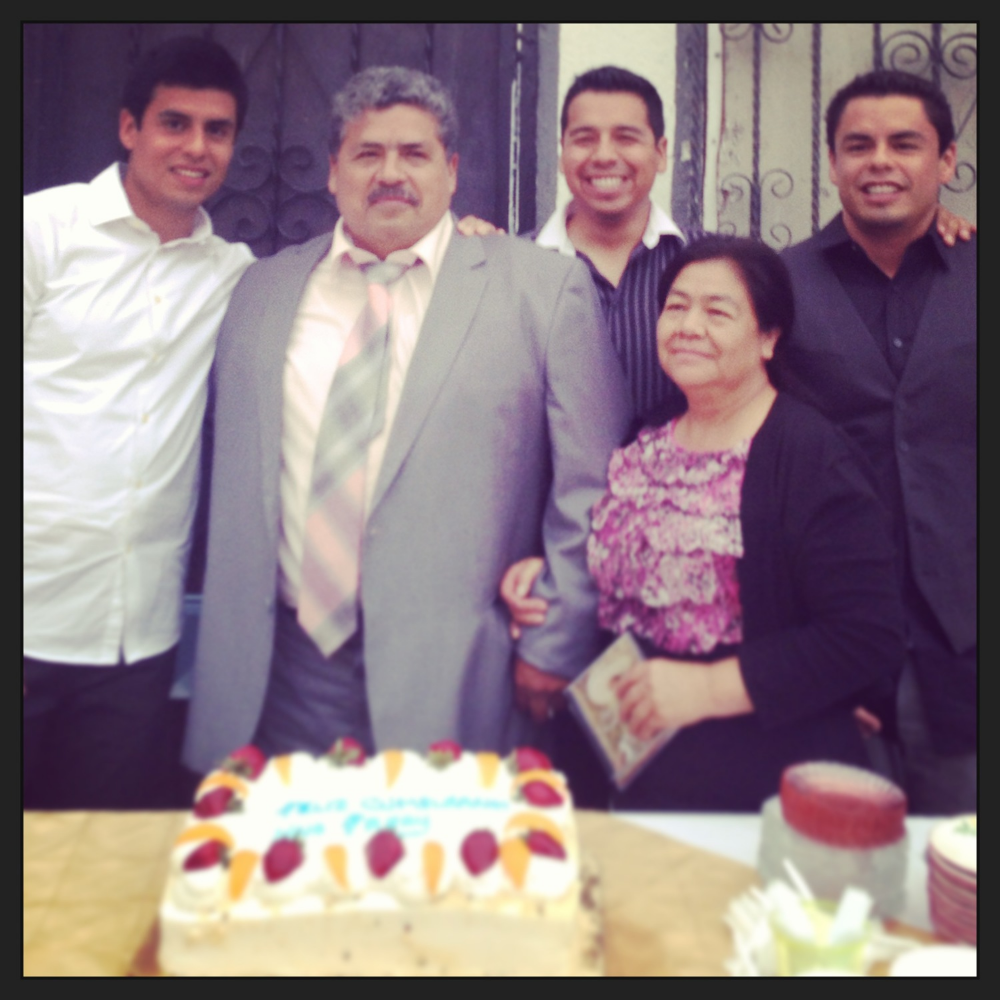 Here we are as a family before cutting his birthday cake last year.