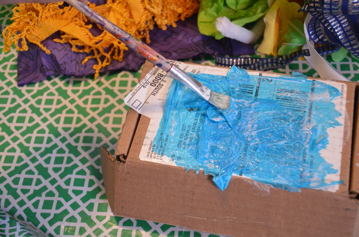 Applying glue over tissue paper.