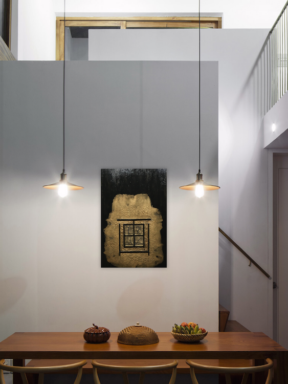 Black and bronze Abstract Painting hanging on dining room wall