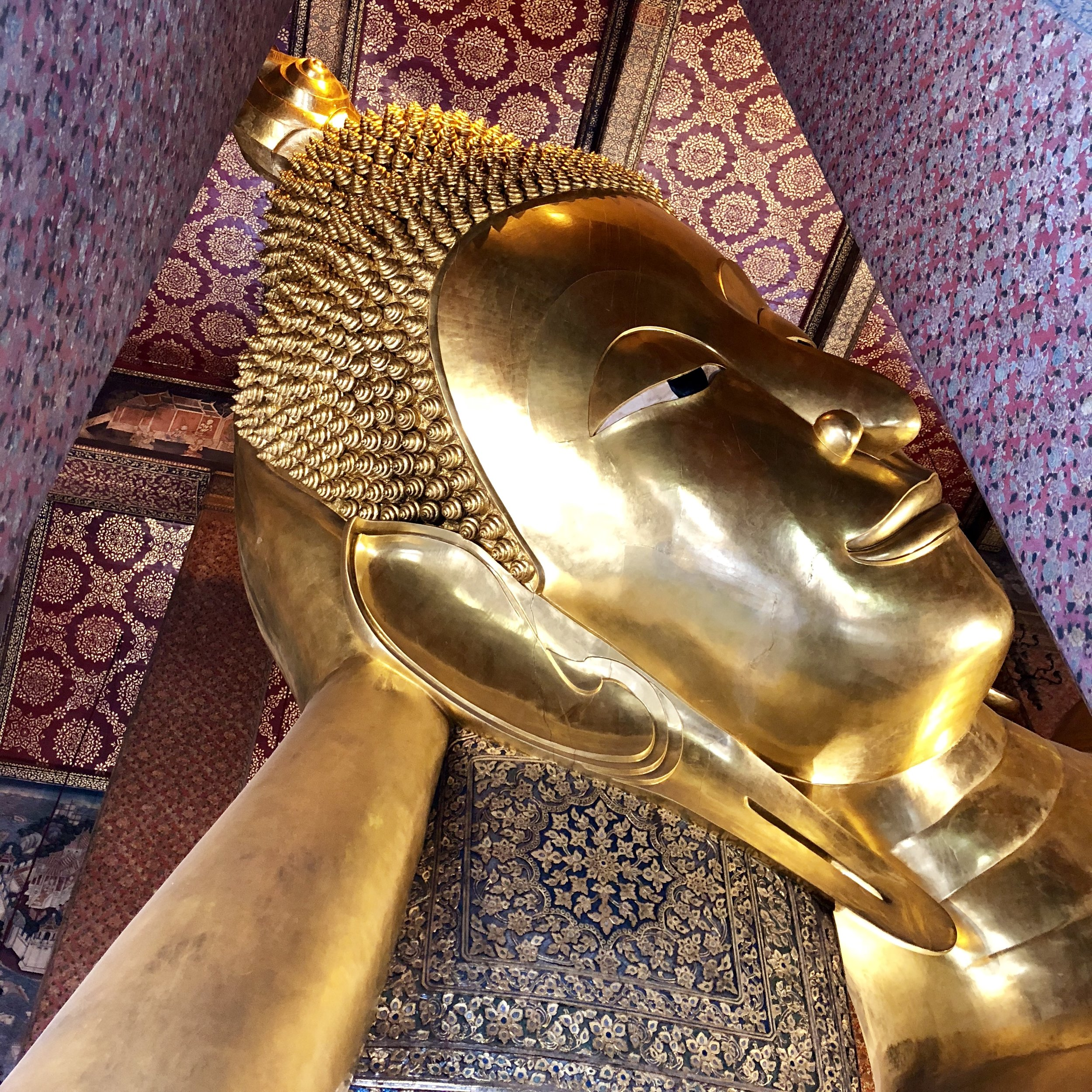 A photograph of the giant reclining Buddha. One of the last images that I expect to take. Note the gorgeous walls, pillars, and ceiling.