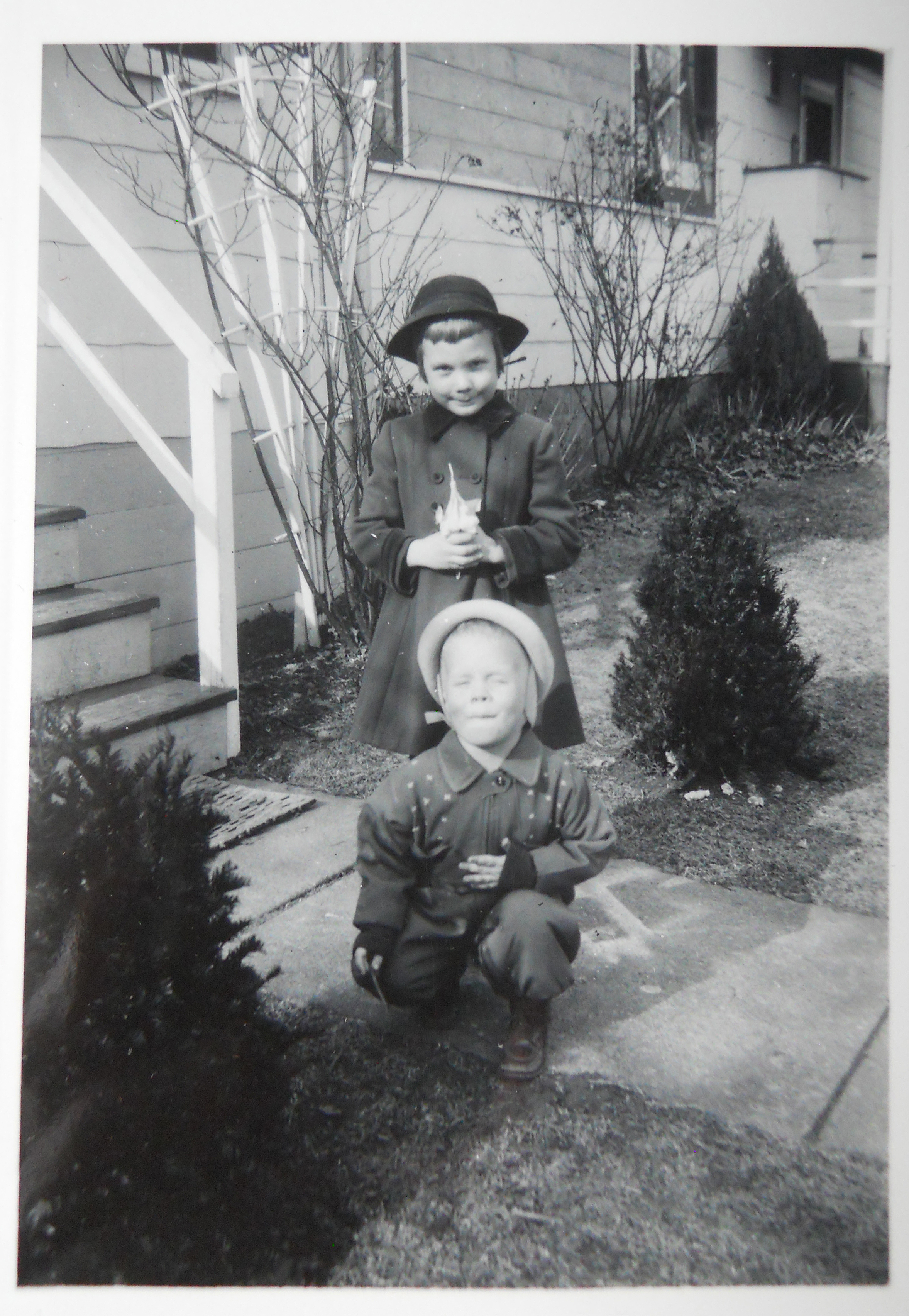 The artist (in back) and her younger brother, Louis .