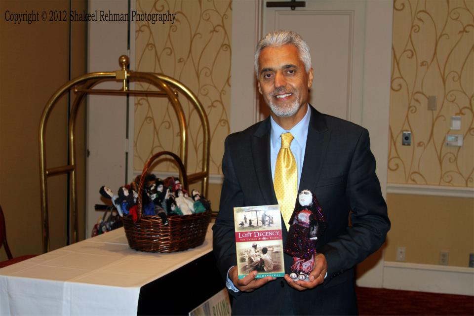 Atta Book and Afghan widow doll.jpg