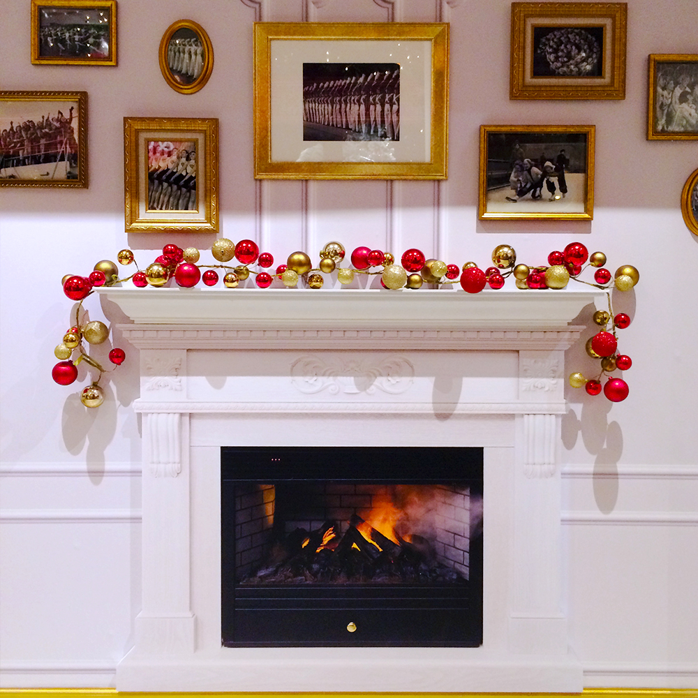 faux fireplace and mini photo museum