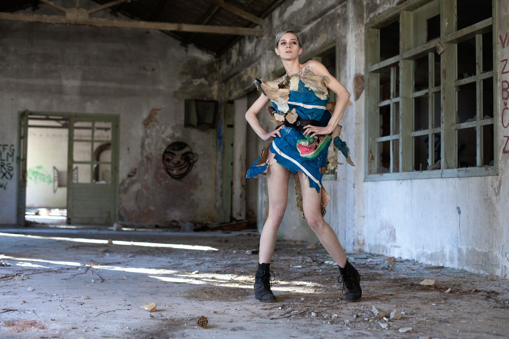 Roxx, shot by Redd, at Pula's abandoned naval base, wearing naturally-weathered discarded paper.
