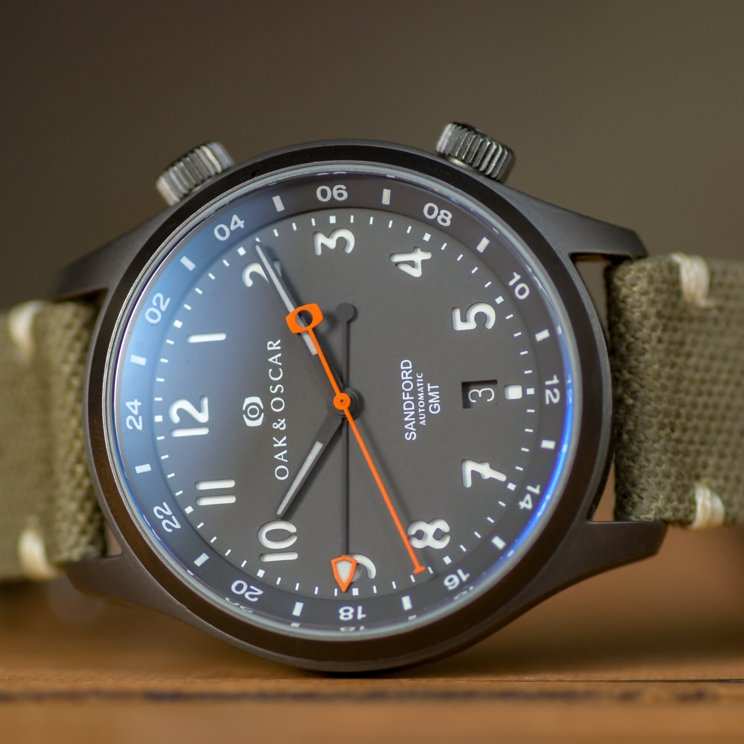 GMT Hand - Inspired by Chase's love of arrowheads and stone tools as both a kid and later in university (he actually took a class on the history of stone tools...!), the GMT hand design mimics that of an arrowhead. The lolli-pop counter balance of the GMT hand fits inside the counter balance of the orange seconds hand perfectly as they sweep by one another.The shape is both unique and distinctive and has become an identifying design detail of the Sandford.
