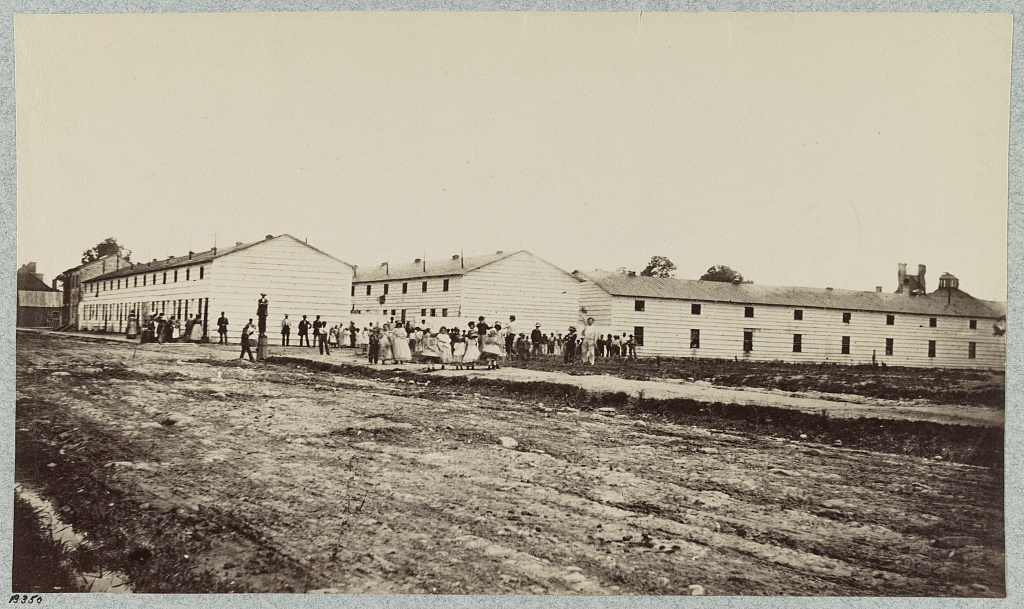Barracks built for freedpeople in Alexandria, Virginia. Wilbur advocated for these homes to be family friendly, clean, and safe.