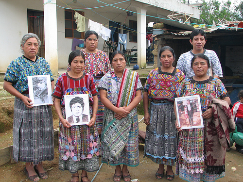 Family members holding pictures of their loved ones who were killed or 'disappeared' during the 30+ year Guatemalan Civil War.