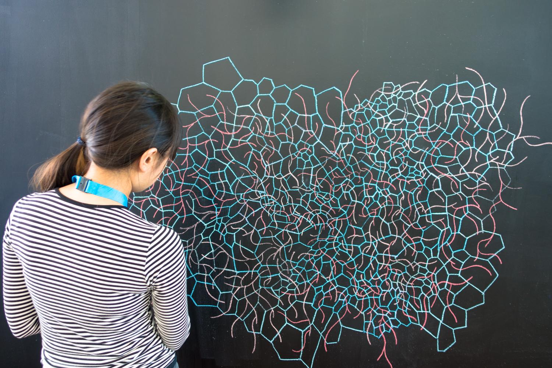 Artist Hanae Shimizu working on her drawing for Urbo KuneatMuziekgebouw aan 't IJ. Photo by Canan Marasligil