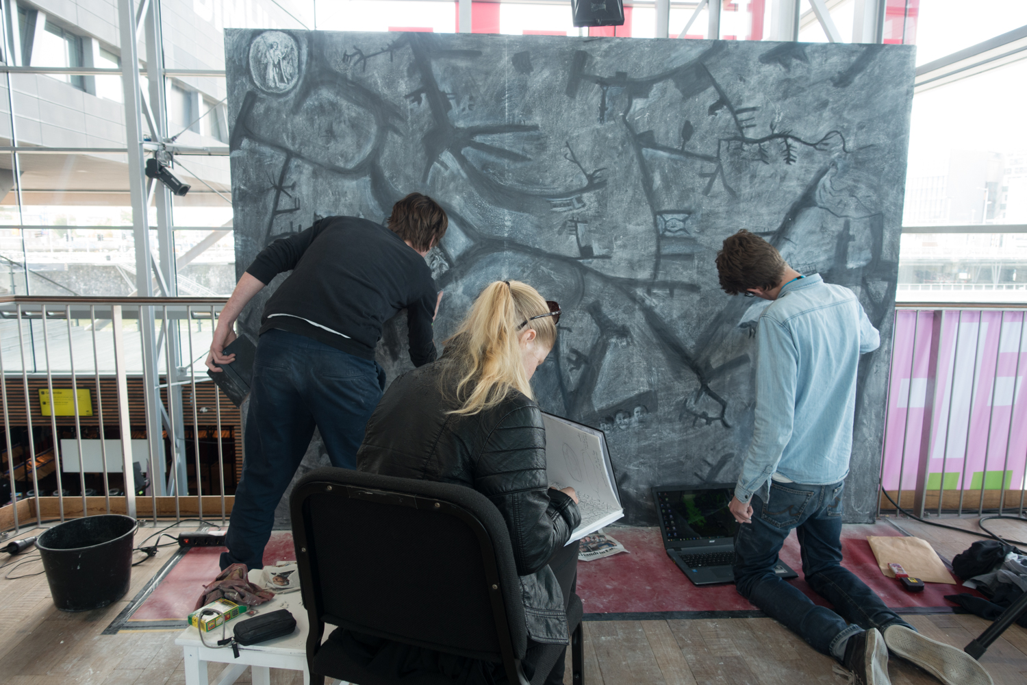 Artists working on their utopic city during Urbo Kune at   the Muziekgebouw aan 't IJ. Photo by Canan Marasligil