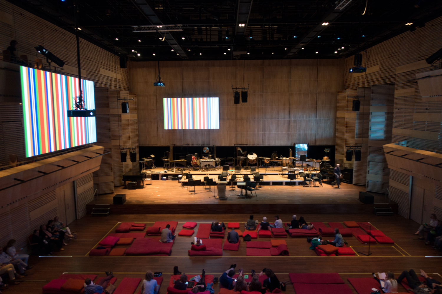Rem Koolhaas's barcode EU flag decorates the inside the Muziekgebouw's main hall during Urbo Kune.   Photo by Canan Marasligil