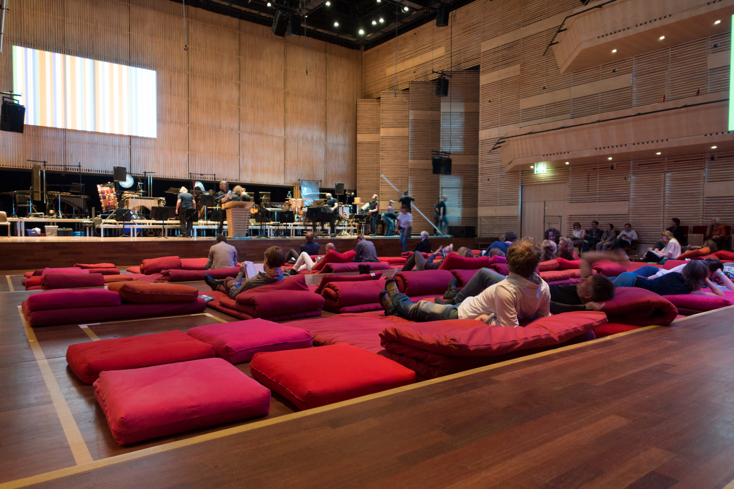 Cosy futons replace concert hall seats: the atmosphere is relaxed inside the Muziekgebouw's main hall    during Urbo Kune. Photo by Canan Marasligil