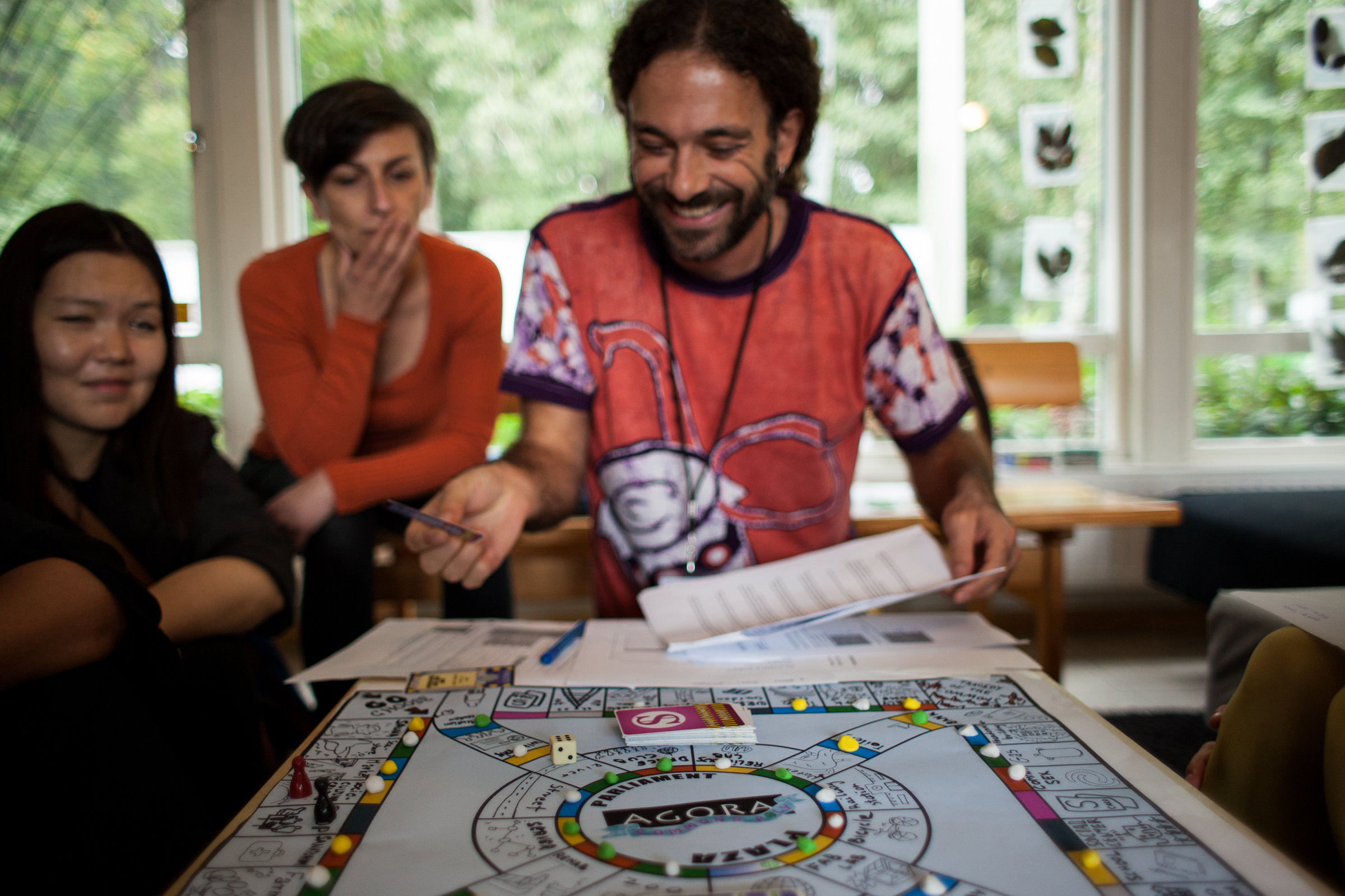 Vassilis Chryssos playing Commonspoly during the Idea Camp 2015.
