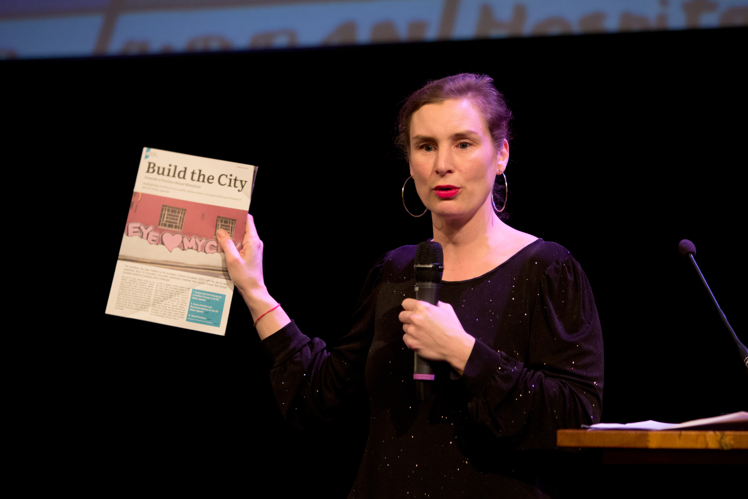 Natasja van den Berg holds the Build the City Manifesto during our Co-creating the City event.Photo by Maarten van Haaff.