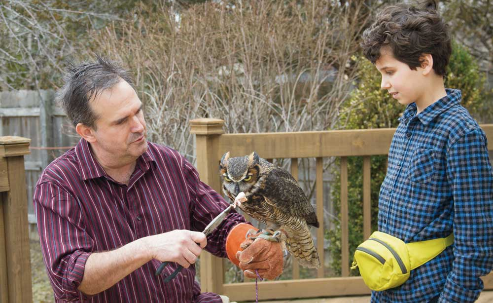 Master Falconer Craig Perdue, Elijah Hatcher-Kay and Rupert the owl