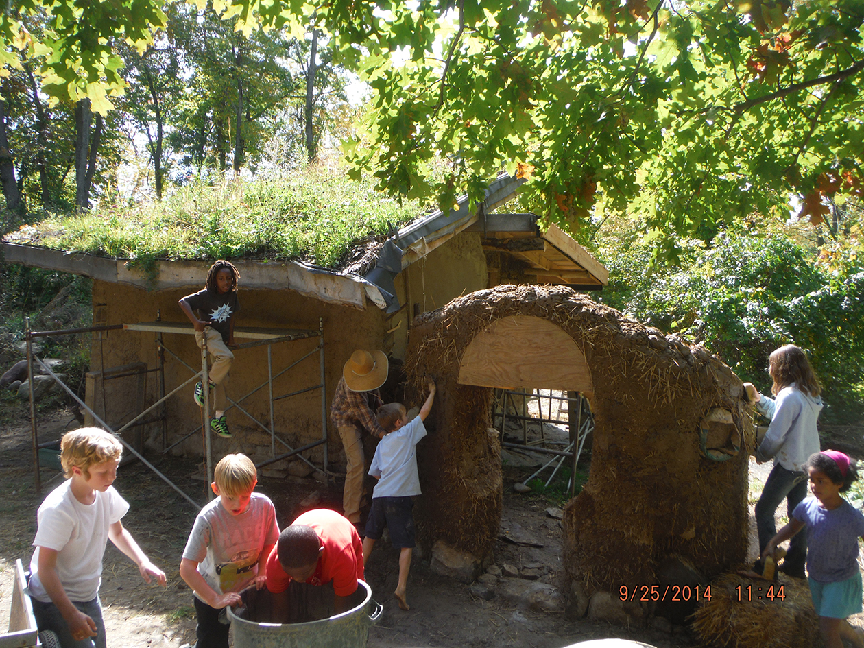 Youth help build a Cob Garden Wall.JPG