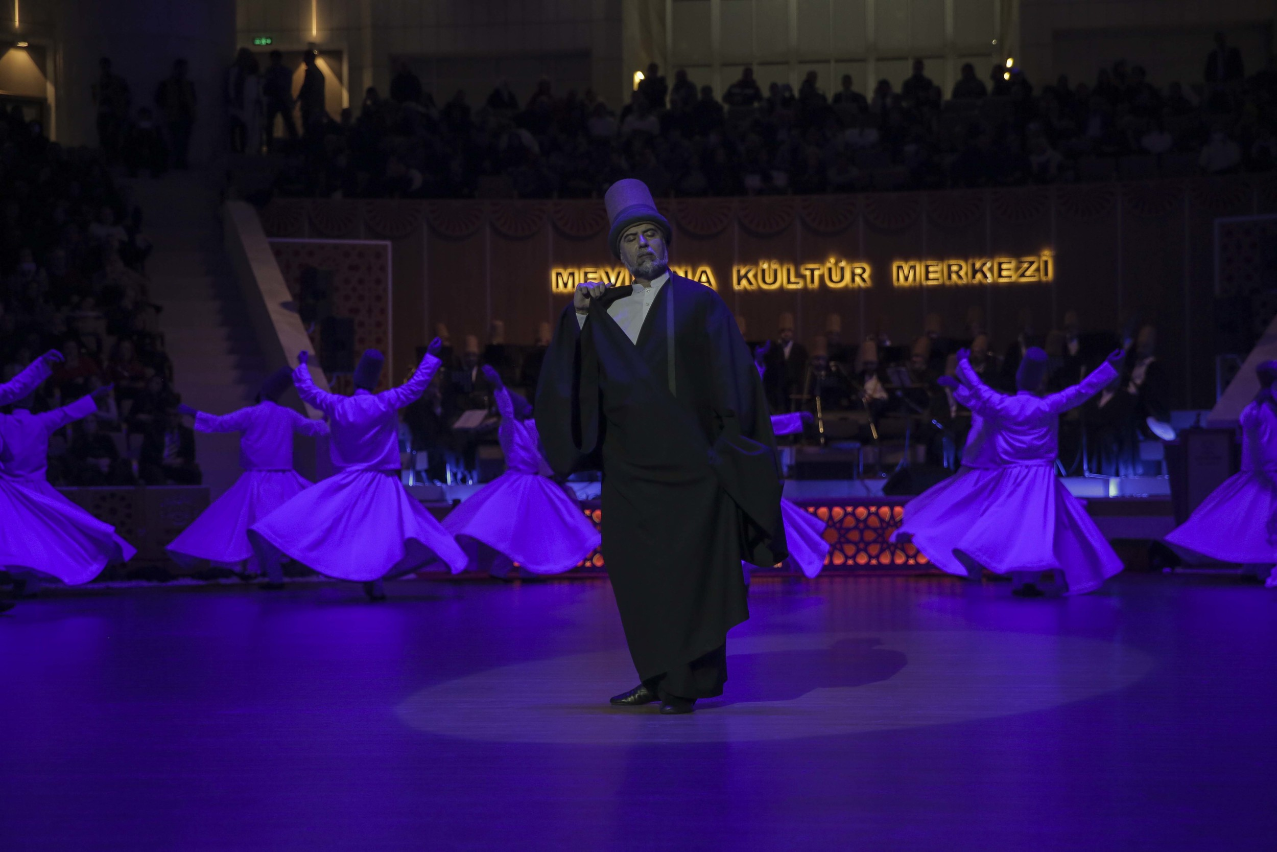 Fahri Ozcakil, the Dede – or head – of the whirling Dervishes and father of Mithat, gently turning in the centre of the other whirling dervishes
