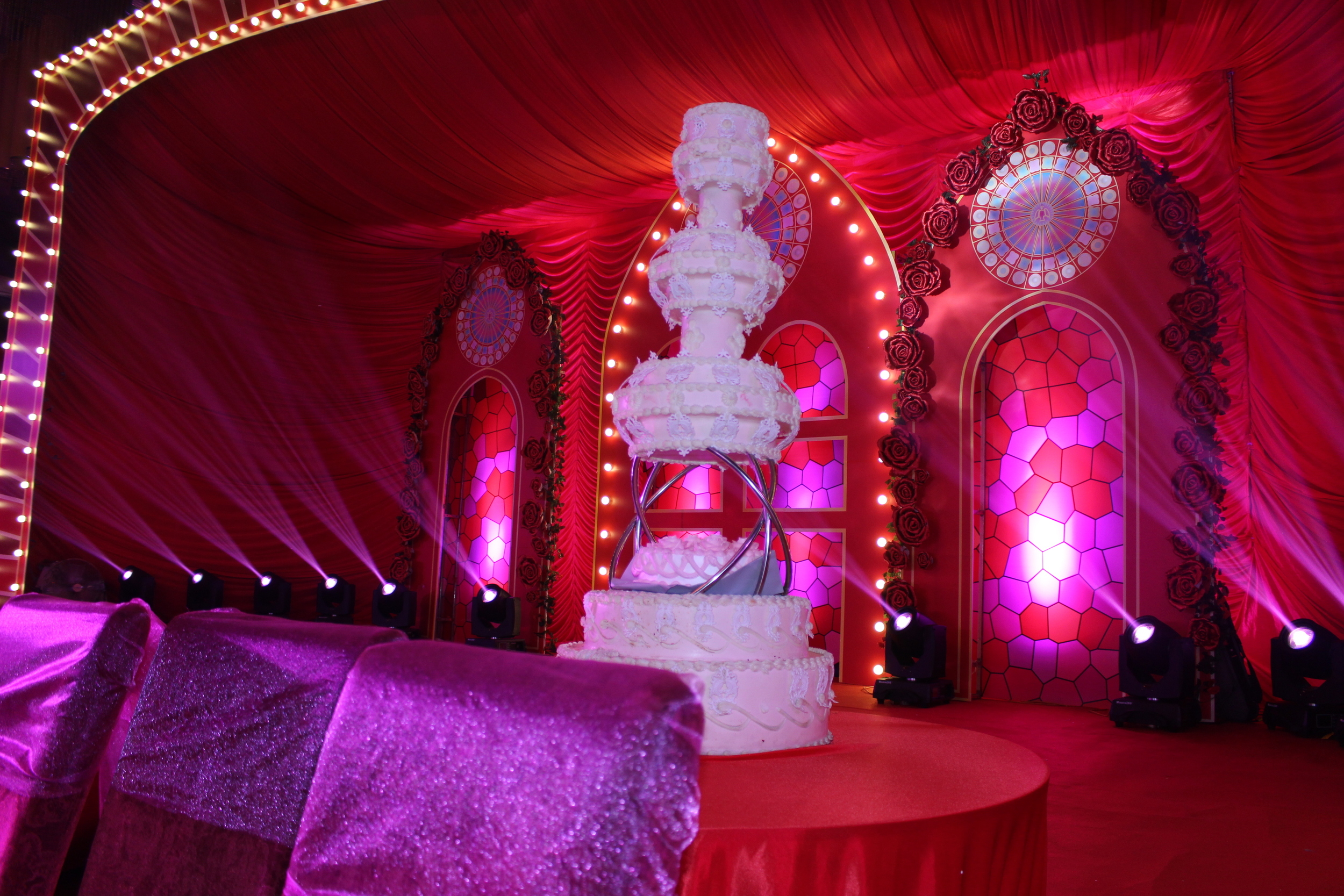 This is a false cake that the bride and groom cut together with a huge sword!