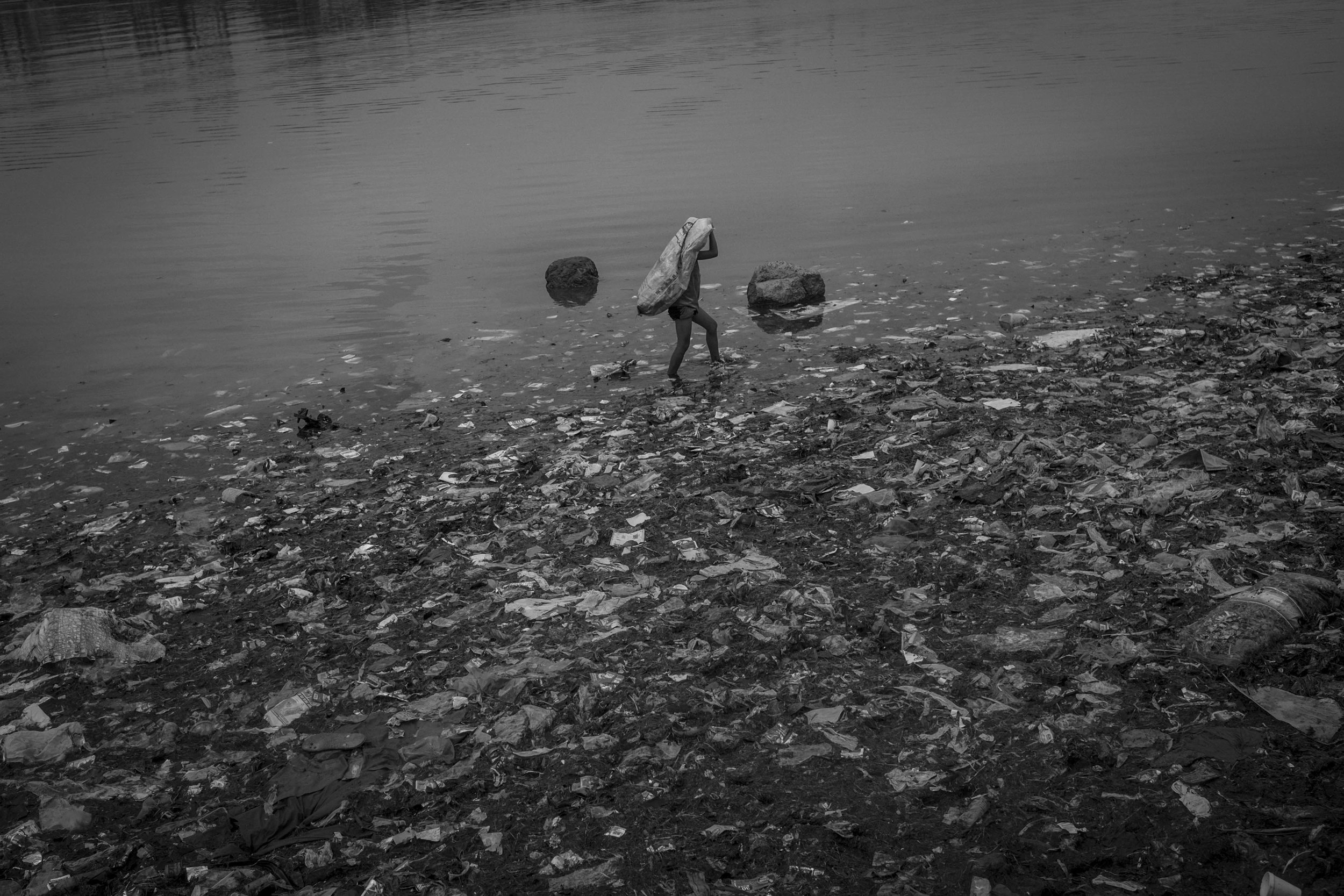 A child collects plastic materials in Baseco compound, in Manila.