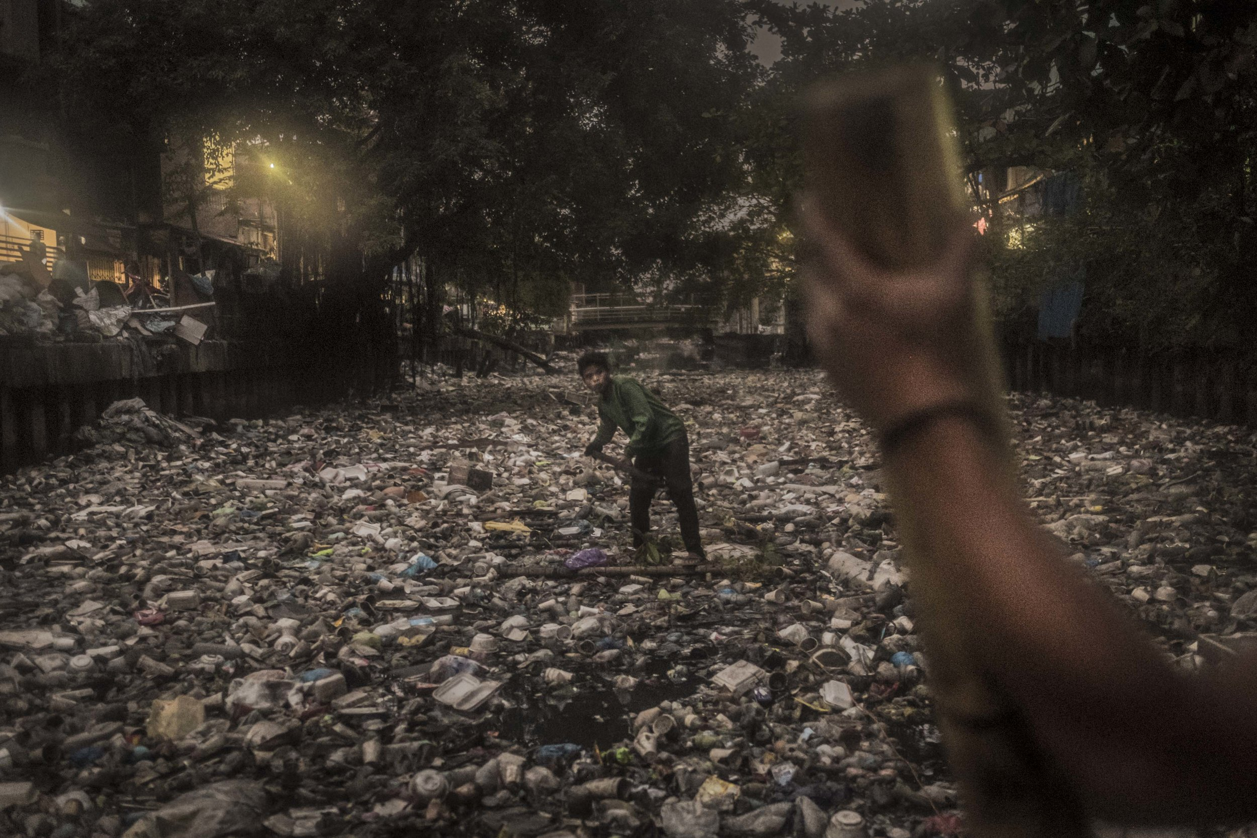 A PRRC river warrior cleaning up the Pasig River in Manila, Philippines